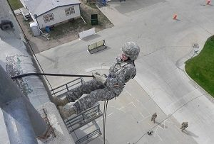 cadet rappeling down side of building